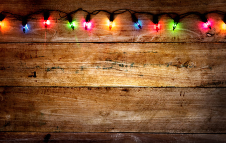 Photo for Christmas rustic background - vintage planked wood with colorful lights and free text space - Royalty Free Image