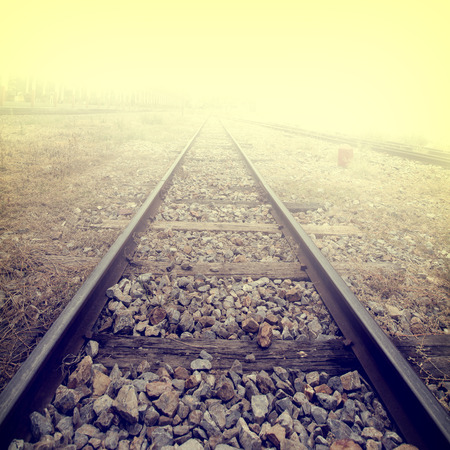 Landscape of railroad tracks at train station - retro, vintage filter effect style