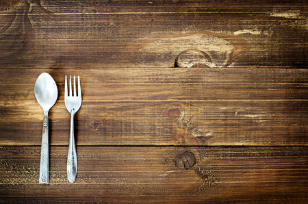 Photo for Vintage silverware on old wood table - Royalty Free Image