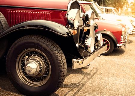 Foto de Detail of front vintage car wheels and headlight - Classic vehicles - Imagen libre de derechos