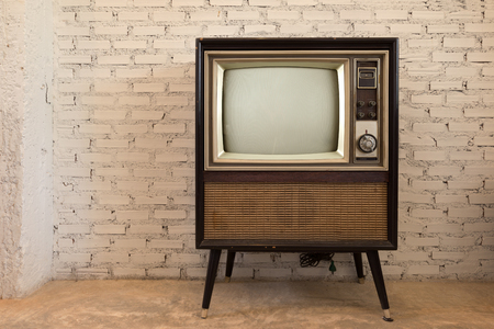 Retro old television in vintage white wall background