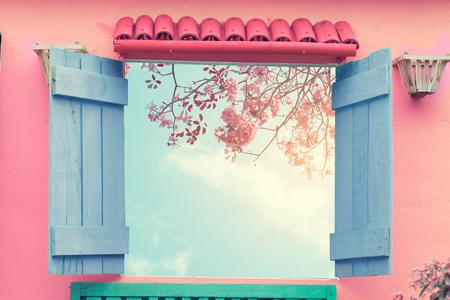 Sweet cute open window with sakura pink flower viewpoint. vintage pastel color effect