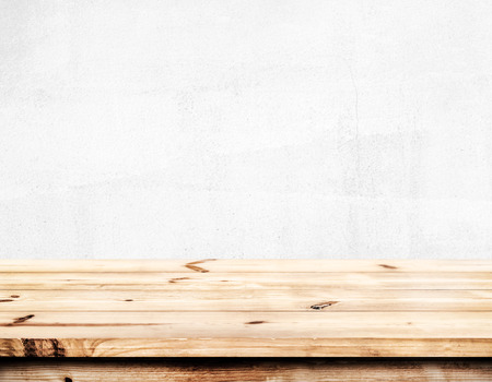 Photo pour Empty pine wood table top ready for your product display montage. with white wall background. - image libre de droit