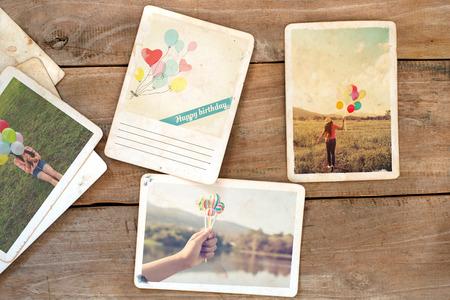 Happy birthday postcard on wood table. instant photo of polaroid camera - vintage and retro style