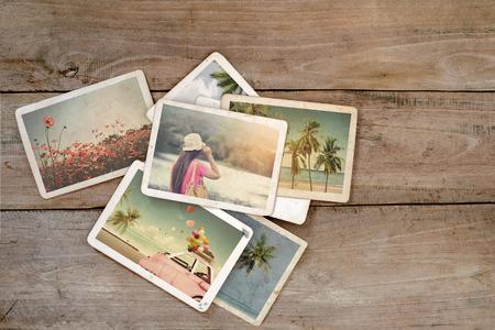 Foto de Summer photo album on wood table. instant photo of polaroid camera - vintage and retro style - Imagen libre de derechos