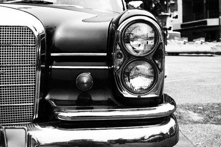 Black and white photo of classic car- vintage film grain filter