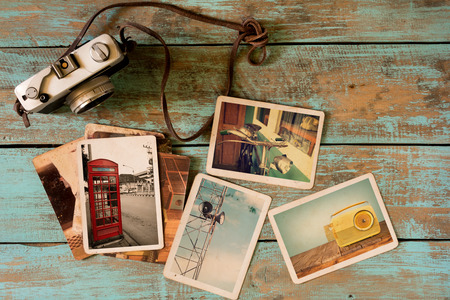 Foto de Retro technology instant photo album on wood table. paper photo of vintage camera - vintage and retro style - Imagen libre de derechos