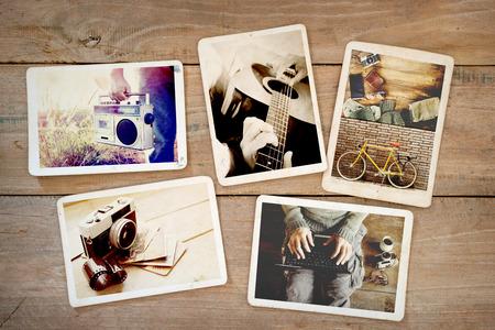 Foto de Photo album of hipster lifestyle journey trip in summer on wood table. instant photo of vintage camera - vintage and retro style - Imagen libre de derechos
