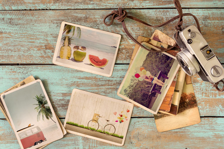 Photo album of journey honeymoon trip in summer on wood table. instant photo of retro camera - vintage and retro style