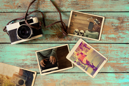 Foto de Photo album of hipster lifestyle journey trip in summer on wood table. instant photo of retro camera - vintage and retro style - Imagen libre de derechos
