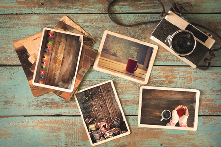 Foto de Merry christmas (xmas) photo album on old wood table. paper photo of polaroid camera - vintage and retro style - Imagen libre de derechos