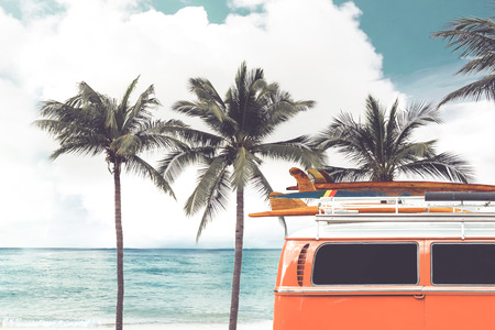 Photo for Vintage car parked on the tropical beach (seaside) with a surfboard on the roof - Leisure trip in the summer. retro color effect - Royalty Free Image