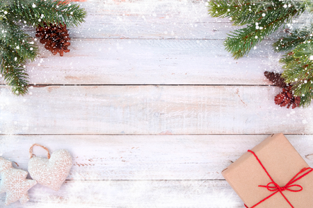 Photo for Christmas background - fir leaves and pine cones decorating rustic elements on white wood table with snowflake. Creative Flat layout and top view composition with border and copy space design. - Royalty Free Image