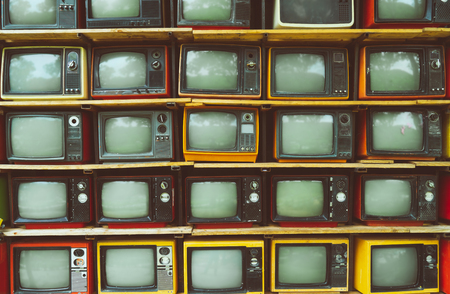 Photo pour Pattern wall of pile vintage television (TV) - vintage filter effect style. retro technology. - image libre de droit