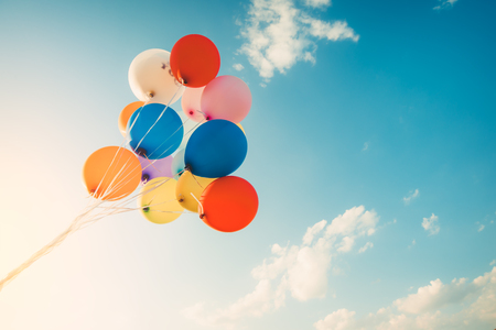 Foto per Colorful balloons done with a retro filter effect. Concept of happy birth day in summer and wedding, honeymoon party use for background. Vintage color tone style - Immagine Royalty Free