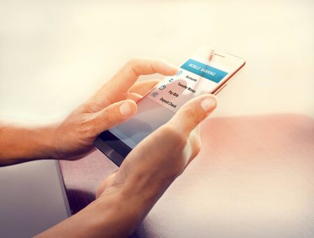 Photo pour Concept online payment mobile technology and financial technology (fintech). Hand of male using mobile banking application on smartphone. Touch button with online transaction application. - image libre de droit