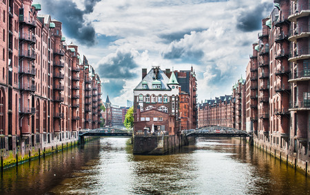 Beautiful view of famous Speicherstadt warehouse district with dark clouds before the storm in Hamburg, Germany