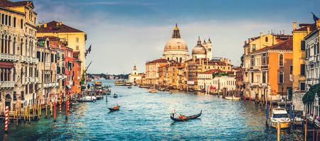 Foto de Panoramic view of famous Canal Grande and Basilica di Santa Maria della Salute at sunset in Venice, Italy with retro vintage effect - Imagen libre de derechos