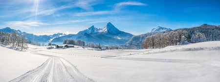 Panoramic view of beautiful winter landscape in the Bavarian Alps with cross-country slopes and famous Watzmann massif in the background, Nationalpark Berchtesgadener Land, Bavaria, Germany