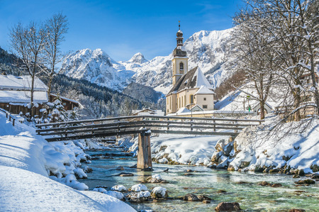 Photo for Panoramic view of scenic winter landscape in the Bavarian Alps with famous Parish Church of St. Sebastian in the village of Ramsau, Nationalpark Berchtesgadener Land, Upper Bavaria, Germany - Royalty Free Image
