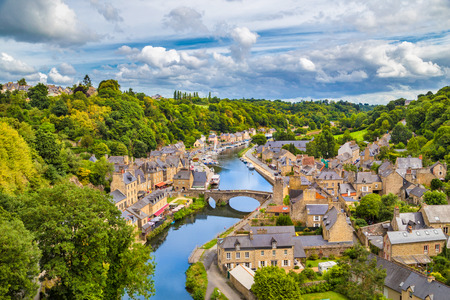 Aerial view of the historic town of Dinan with Rance river with dramatic cloudscape, Cotes-d'Armor department, Bretagne, northwestern France