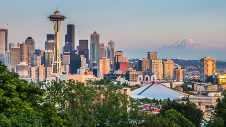 Seattle skyline panorama seen from Kerry Park at sunset in golden evening light with Mount Rainier in the background, Washington State, United States of America