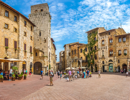 Panoramic view of famous Piazza della Cisterna in the historic town of  San Gimignano on a sunny day, Tuscany, Italy