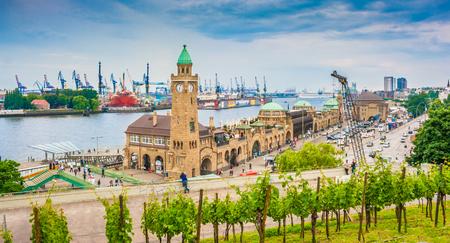 Famous Hamburger Landungsbruecken with commercial harbor and Elbe river, St. Pauli district, Hamburg, Germany