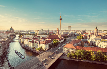 Foto de Aerial view of Berlin skyline with famous TV tower and Spree river in beautiful evening light at sunset with retro vintage Instagram style grunge pastel toned filter effect, Germany - Imagen libre de derechos