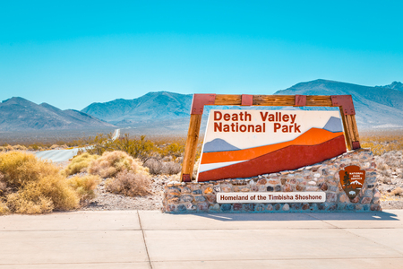 Photo pour Classic view of famous Death Valley National Park entrance sign on a sunny day with blue sky in summer, California, USA - image libre de droit