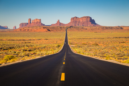Photo pour Classic panorama view of historic U.S. Route 163 running through famous Monument Valley - image libre de droit