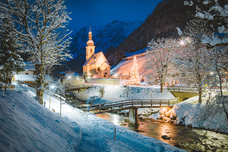 Photo for Beautiful twilight view of Sankt Sebastian pilgrimage church with decorated Christmas tree illuminated during blue hour at dusk in winter, Ramsau, Nationalpark Berchtesgadener Land, Bavaria, Germany - Royalty Free Image