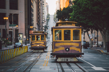 Foto de Classic panorama view of historic San Francisco Cable Cars on famous California Street at sunset with retro vintage style filter effect, central San Francisco, California, USA - Imagen libre de derechos
