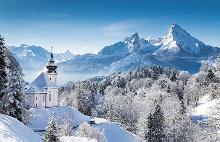 Photo for Panoramic view of beautiful winter wonderland mountain scenery in the Bavarian Alps with pilgrimage church of Maria Gern and famous Watzmann massif in the background, Nationalpark Berchtesgadener Land, Bavaria, Germany - Royalty Free Image