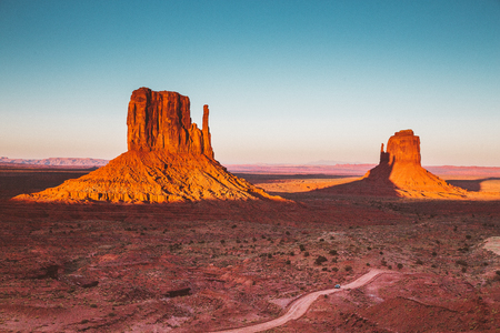 Photo pour Classic view of famous Monument Valley with the West Mitten's shadow being cast on the East Mitten in beautiful golden evening light at sunset, Arizona, USA - image libre de droit