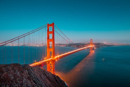Photo for Classic panoramic view of famous Golden Gate Bridge seen from Battery Spencer viewpoint in beautiful post sunset twilight during blue hour at dusk in summer, San Francisco, California, USA - Royalty Free Image