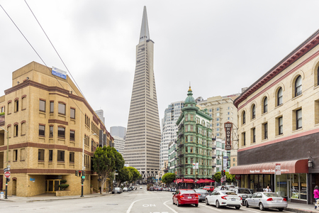 Photo for Central San Francisco with famous Transamerica Pyramid and historic Sentinel Building at Columbus Avenue on a cloudy day, California, USA - Royalty Free Image