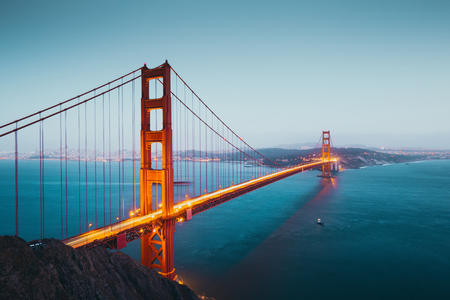 Photo for Panoramic view of famous Golden Gate Bridge seen from Battery Spencer viewpoint in beautiful post sunset twilight during blue hour at dusk, San Francisco, USA - Royalty Free Image