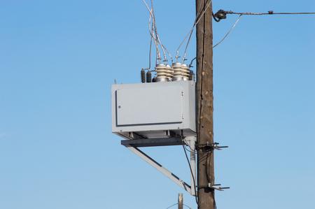 Transformation station at pole on blue sky background