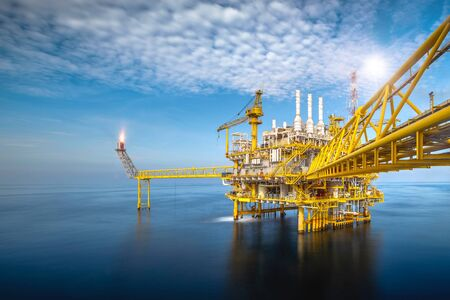 Photo for Offshore oil and gas platforms are in the process of releasing gas to the flame platform to reduce the pressure in the production process and forward the converted refinery. For the petroleum industry - Royalty Free Image