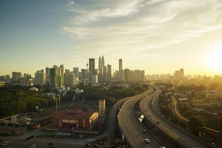 Dramatic scenery of elevated highway heading towards Kuala Lumpur city centre during sunset.