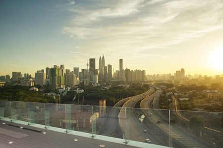Dramatic scenery of elevated highway heading towards Kuala Lumpur city centre during sunset.