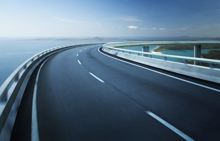 Foto de Highway overpass motion blur with coast skyline background . - Imagen libre de derechos