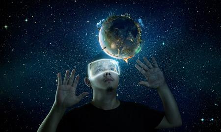 Photo pour Man wearing futuristic virtual reality glasses . - image libre de droit