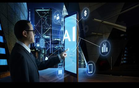 Photo pour Businessman touching AI word on screen of digital booth with fintech infographic. Hi-tech business concept . - image libre de droit
