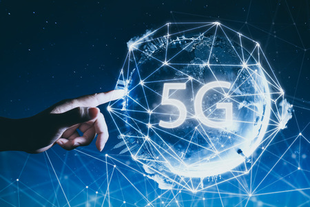 Foto de 5G network wireless systems and internet of things with man touching Abstract global with wireless communication network on space background . - Imagen libre de derechos