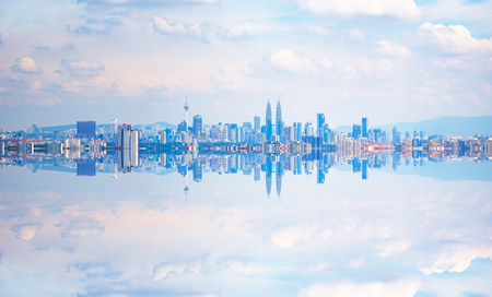 Photo pour Kuala Lumpur city skyline with stunning reflection in water . - image libre de droit