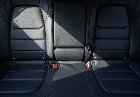 Photo pour Closeup of a modern car interior with the black leather rear seats - image libre de droit