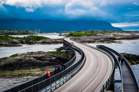 Foto de Atlantic Ocean Road, passing through the several small islands in Norwegian Sea and is part of National Tourist Routes of Norway. One of most famous landmarks. Beautiful blue cloudy summer landscape. - Imagen libre de derechos