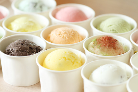sweet and colorful ice cream scoops in white cups